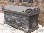 Gadara - Black Basalt Sarcophigus with 4 horns, arched top and carved sides.