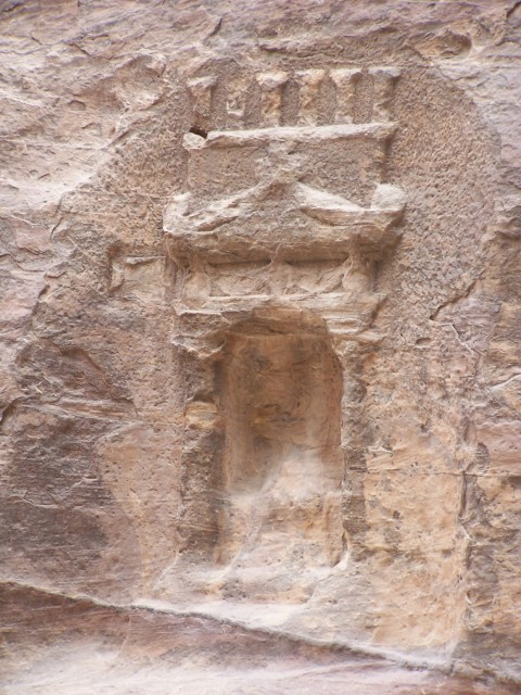 Petra - As you walk along the siq you can find many additions to the canyou - here a small niche,  probobly a ceremonial worship spot for the Nabetians.